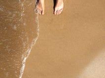 Feet on the seashore, ocean, Maui Hawaii USA Royalty Free Stock Image