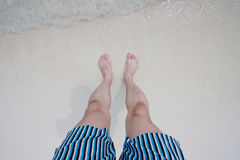 Feet on a seaside beach Stock Photos