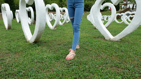 Feet Selfie in Sandals Standing on Green Grass with White Heart Shape Artificial Background. Great For Any Use Royalty Free Stock Photos