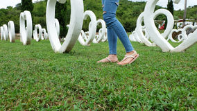 Feet Selfie in Sandals Standing on Green Grass with White Heart Shape Artificial Background. Great For Any Use Stock Images
