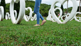 Feet Selfie in Sandals Standing on Green Grass with White Heart Shape Artificial Background. Great For Any Use Royalty Free Stock Photography