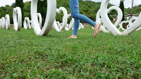 Feet Selfie in Sandals Standing on Green Grass with White Heart Shape Artificial Background. Great For Any Use Stock Photo