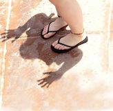 Feet On Shadow of Hands Stock Images