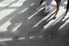 Feet and shadows at Musee De L'Orangerie, Paris, France, Architect Blp Architects - August 2015 Royalty Free Stock Photo