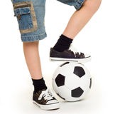 Feet shod in sneakers and soccer ball Royalty Free Stock Photography