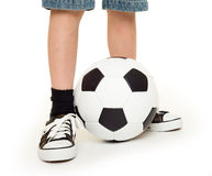 Feet shod in sneakers and soccer ball Stock Photo