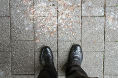 Feet and shoe beside pigeon droppings Stock Photo