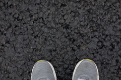 Feet in the shoes on the new asphalt Stock Images