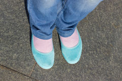 Feet and shoes. Selfie image. Feet and blue shoes with jeans. Selfie image Stock Photo