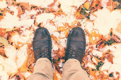 Feet shoes walking in nature. Legs in boots on autumn leaves. Filtered image Stock Image