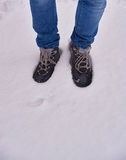 Feet in shoes in the white snow Royalty Free Stock Photo