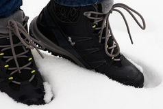 Feet in shoes in the white snow. Feet in shoes in the snow Stock Photography