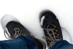 Feet in shoes in the white snow. Feet in shoes in the snow Royalty Free Stock Images