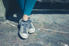 The feet and shoes of a young woman Royalty Free Stock Photo