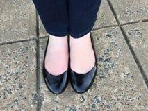 Feet on sidewalk Stock Images