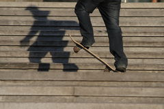 Feet and skate. A young man goes on skateboard on stairs Royalty Free Stock Photos