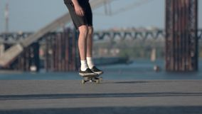 Feet of a skateboarder. Person with skateboard outdoors. Mastery starts from the simple. Ride with me stock video