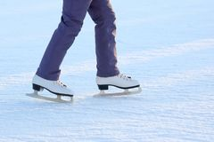 Feet on the skates of a person rolling on the ice rink Royalty Free Stock Photography