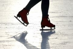 Feet skating on the ice rink