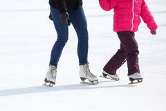Feet skating on the ice rink. The feet skating on the ice rink Royalty Free Stock Image