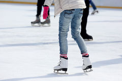 Feet skating on the ice rink. The feet skating on the ice rink Royalty Free Stock Images