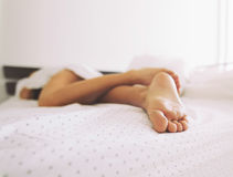 Feet of a sleeping woman Royalty Free Stock Photography