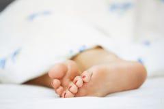 Feet of sleeping woman Stock Photo