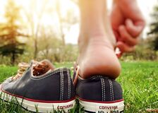 Feet in sneakers Stock Photography