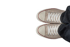 Feet in sneakers from above 2. Feet in sneakers from above. isolated on white background. and made with selective focus Stock Images