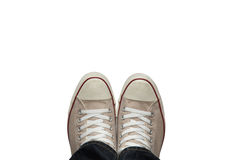 Feet in sneakers from above 3. Feet in sneakers from above. isolated on white background. and made with selective focus Royalty Free Stock Photography