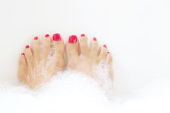 Feet soaking in spa bath Royalty Free Stock Photography