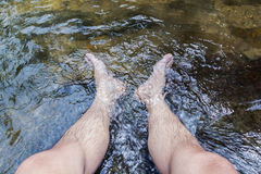 Feet soaking in the water Royalty Free Stock Image