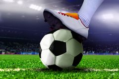 Feet on Soccer Ball in the Stadium Stock Images