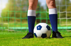 Feet of soccer player with ball. Royalty Free Stock Images
