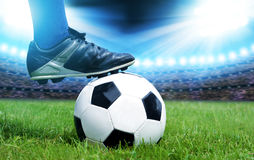 Feet of soccer player with ball Stock Images