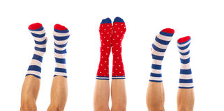 Feet in socks. Feet in striped and dotted socks isolated over white background Royalty Free Stock Images
