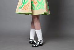 Feet in soft irish dance shoes. Irish dancer feet on grey Stock Photos