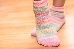Feet in soft socks. Close up of feet in colorful soft socks stock photography