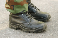 Feet of soldier in military boots anduniform Stock Photo