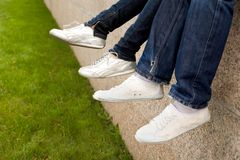 Feet in sportshoes Stock Photos