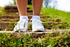 Feet in sportshoes Stock Photo