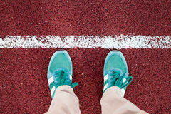 Feet are on the stadium track Stock Photo