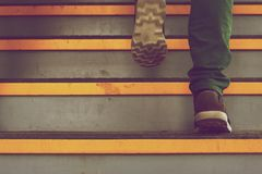 Feet on stairs Stock Photography