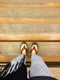 Feet on stairs. Feet on the wood stairs Royalty Free Stock Photos
