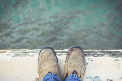 Feet Standing on Cement Edge Stock Photo