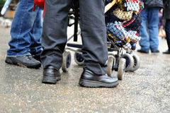 Feet standing near stroller Stock Photos