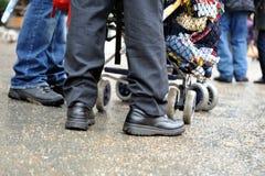 Feet standing near stroller Stock Photos