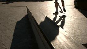 Feet standing on skateboard. Shadow of a skateboarder. Feeling of balance. I choose sports stock footage