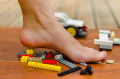 A feet standing up on Legos of various colors
