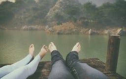 Feet standing on a wooden Stock Photos